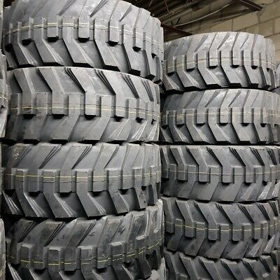 12X16.5 - 4 NEW ROAD WARRIOR 14 PLY SKID STEER TIRES 12-16.5 NHS With Rim Guard