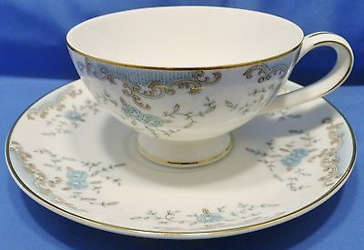 Imperial Japan white china Seville design footed cup & saucer, blue grey floral