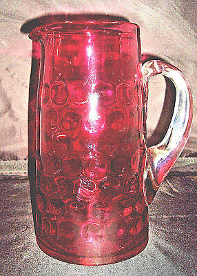 """Cranberry 9"""" pitcher Inverted Thumbprint  with clear applied handle"""