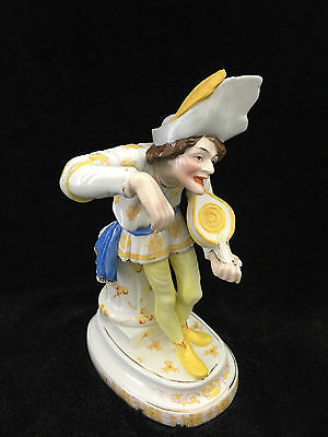 CONTINENTAL PORCELAIN FIGURINE OF MUSICIAN, 21 cm HEIGHT