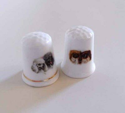 Two Vintage Dog Themed Porcelain Thimbles