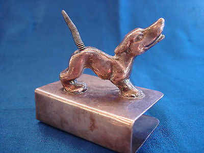 Antique/vintage matchholder box type with figure of dog on top