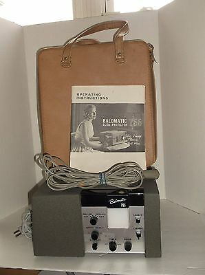 Bausch & Lomb Balomatic Slide Projector 655 with carrying case and Clicker