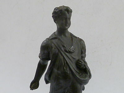 Antique Spelter Figure Of Young Farm Hand / Feed In One Hand Bag In Other