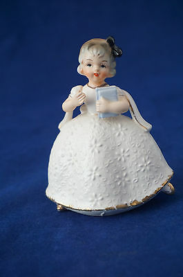 Vintage Porcelain Figurine of a Girl in Victorian Dress holding books