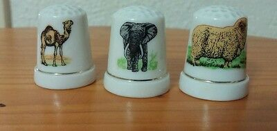 3 ANIMAL THIMBLES (camel, elephant, ram?) collectable