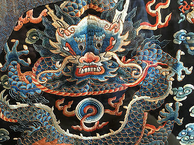 A Rare and Important Qing Dynasty Embroidered Silk Dragon Robe, Framed.