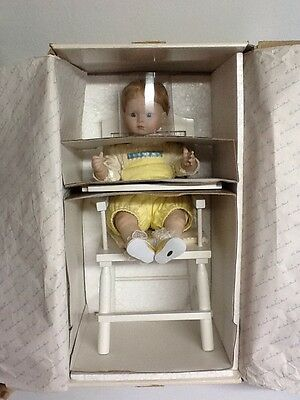 "Preowned RARE The Danbury Mint Porcelain Baby ""Sitting Pretty"" With High Chair!"