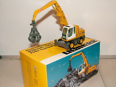 NZG No 497 is the model of the Liebherr A 316 Materials handler with hi lift cab