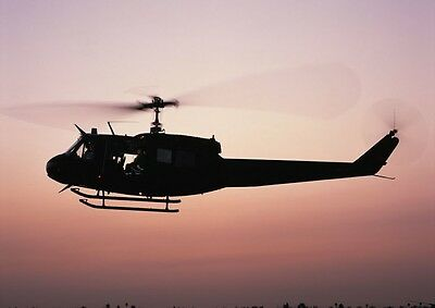 Canvas UH-1 Huey Helicopter Against Pink Sky Art print POSTER