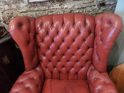 red leather buttonback armchair