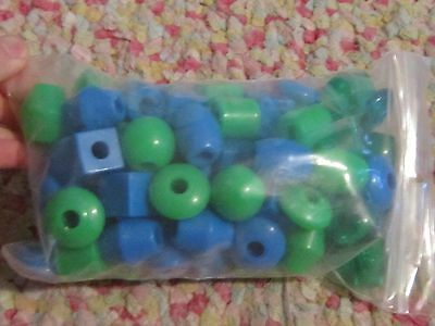 Bag full of big chunky blue and green plastic beads for crafting crafts sewing