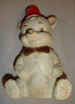 Collectible Plastic Sitting Polar Bear with hat. squeeky toy