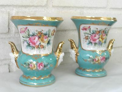 Beautiful Porcelain Urns or Vases Pair Each with Male Head Handles