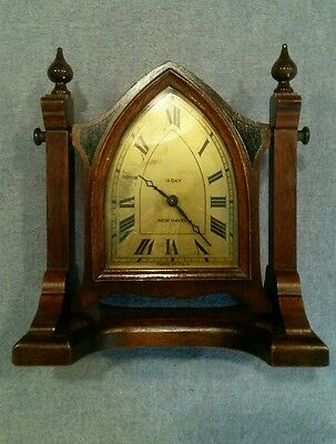 Antique New Haven Mini Cathedral mahogany 12 day clock on a stand & running
