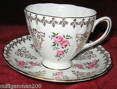 1 - Colclough Red Roses and gold Tea cup and Saucer (2015-124)