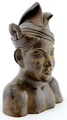An Indonesian / Bali carving of a man. Wooden sculpture. Good detail. Some age