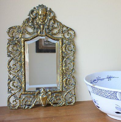 Antique French Rococo Brass Wall Mirror. 19th Century Victorian With Cherub Mask