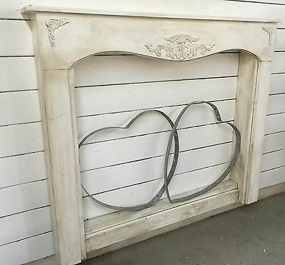 Antique inspired french country mantle with surrounds...72 inches by 50 tall
