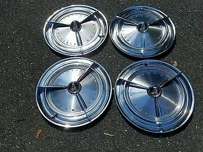 1960 Pontiac accessory spinner Hubcaps W/ Bullet center in the GM Box Lead Sled