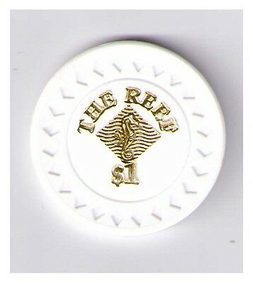 $1 The Reef  - Cairns - Casino Chip with Diamond shape etched around edge