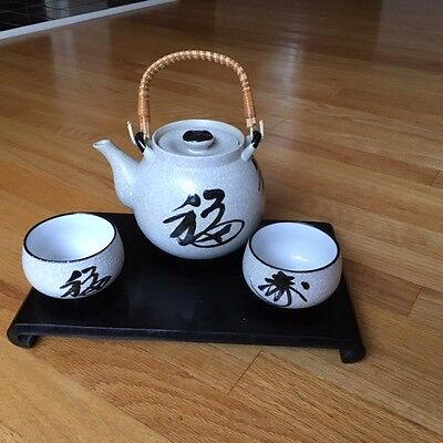 vintage mid century modern/Asian/Japanese tea pot and cups/pottery/wicker handle