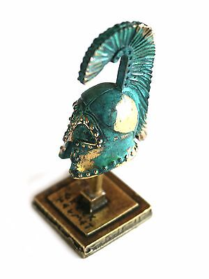 ANCIENT GREEK ZAMAC MINIATURE ATHENIAN BATTLE HELMET ON A STAND green-gold