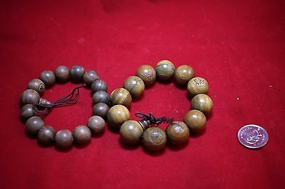 Two Chinese Green Tan Wood Bracelets