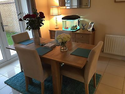 Solid oak extendable dining table and 4 chairs for Dining room tables next