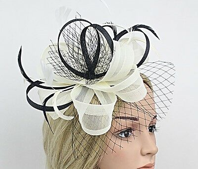Stunning Ivory And Black Sinamay Fascinator With Netting And Matching Feathers
