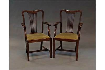 A pair of George III style open arm dining chairs, 20th century,