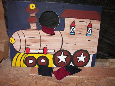 1  Brown  train with  4  bean  bags toss