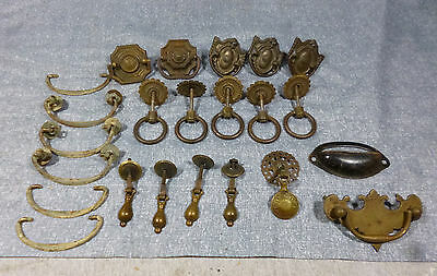 Collection of 23 various sized and type antique brass drawer pulls.