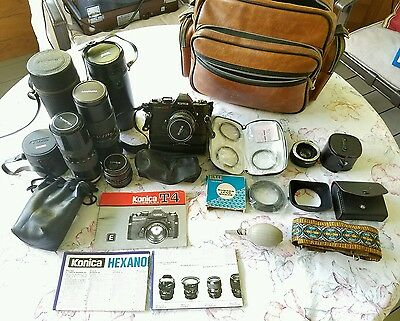 Konica T4 SLR w/ 4 lenses, cases, filters, winder, and more!