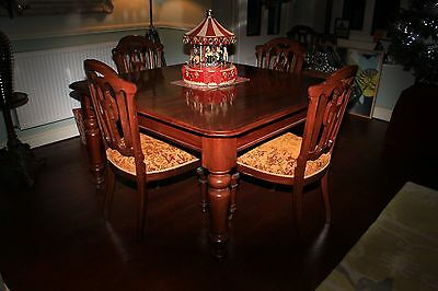 Antique extending table with matching chairs