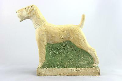 A vintage studio pottery sculpture of an Airedale Terrier. Signed. Art Deco era