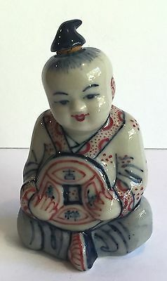 Chinese Figural Snuff Bottle, Ceramic, Person Child ? Holding Lucky Coin