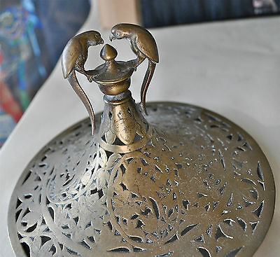 Mughal or Persian 19th c. brass cover with parrot finials and cut out flowers an