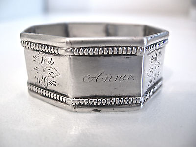 Ornate 8-sided sterling silver napkin ring engraved ANNIE.  Pre-1880 early ring