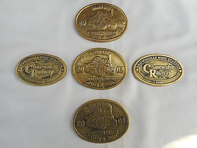 a set of 5 steam / traction brass plaques