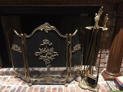 Brass fireplace set with tools and log holders