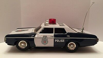 Vintage Battery Operated Tin Police Car - Light on top lights up
