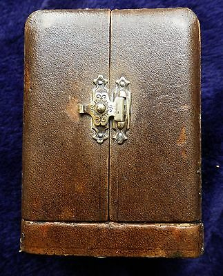 Antique leather on wood carriage clock case