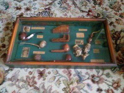framed collection of smoking pipes 8 in total