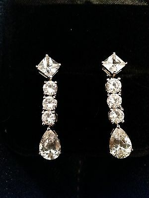 Sterling silver cz dangle glam earrings.