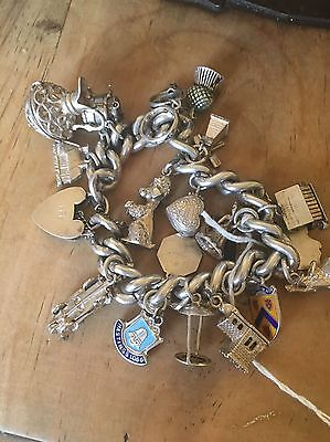 1950's solid silver charm bracelet with 19 charms very heavy 118 grams