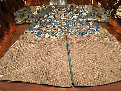 An Important Chinese Qing Dynasty Blue Ground Kesi Dragon Robe.