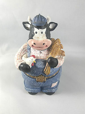 Cow in Jeans holding a Chicken and Wheat Tricket Box