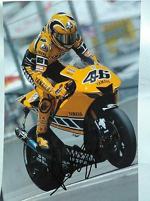 Ventino Rossi hand signed  12 x 8 photograph Kenny Roberts colours ..standing