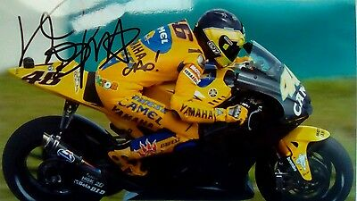 Valentino Rossi hand signed  12 x 8 photograph testing Camel colours